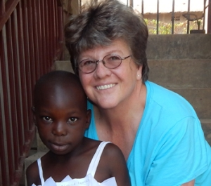 Laura Link with a child sponsored through Children of Promise.